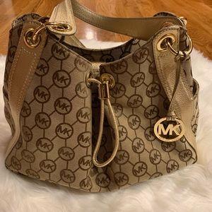 Michael Kors gold handbag